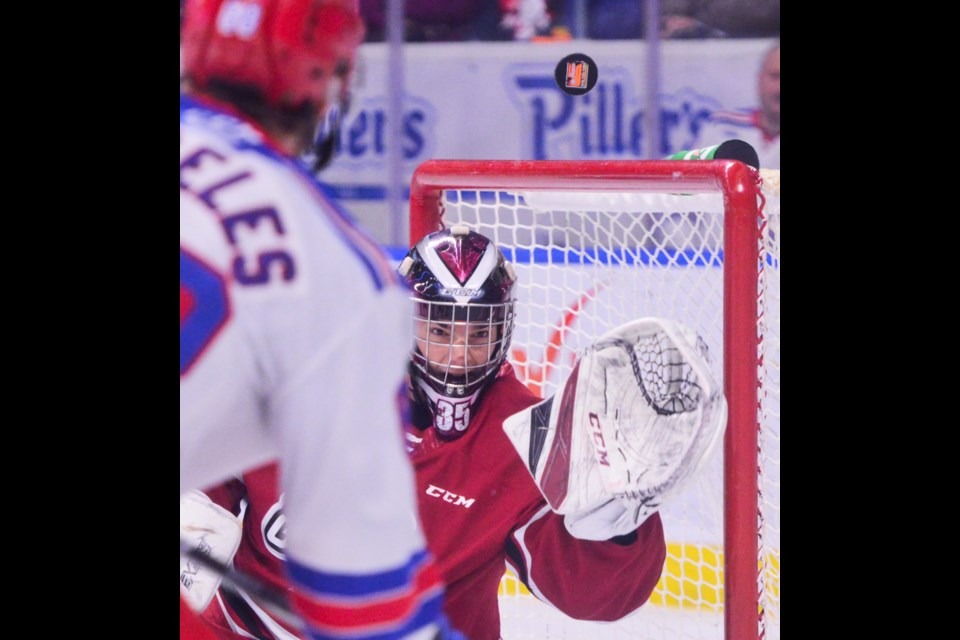 Guelph Storm goaltender Nico Daws watches as a shot goes up in the air Sunday at The Aud in Kitchener. Tony Saxon/GuelphToday