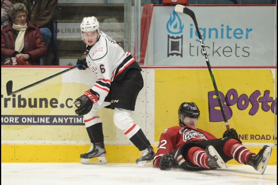 The Guelph Storm's Ben McFarlane recovers after being hit by Owen Sound's Nolan Seed. Tony Saxon/GuelphToday