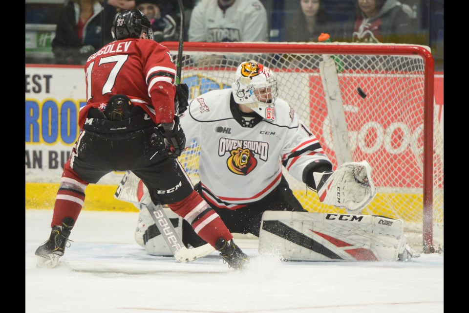 The Guelph Storm's Pavel Gogolev scores on a penalty shot against the Owen Sound Attack's Mack Guzda Friday. Tony Saxon/GuelphToday