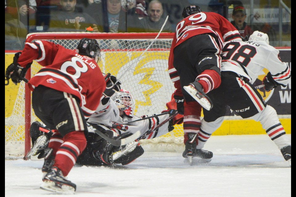 Niagara IceDogs goaltender Nicolas Sbaraglia makes the initial save on Fedor Gordeev in overtime but Cam Hillis would swoop in for the rebound to win the game for Guelph. Tony Saxon/GuelphToday