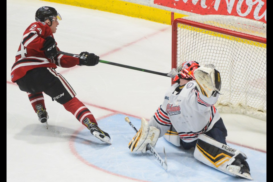 The Guelph Storm's Matt Papais scores the shootout winner on Oshawa Generals goaltender Jordan Kooy. Tony Saxon/GuelphToday