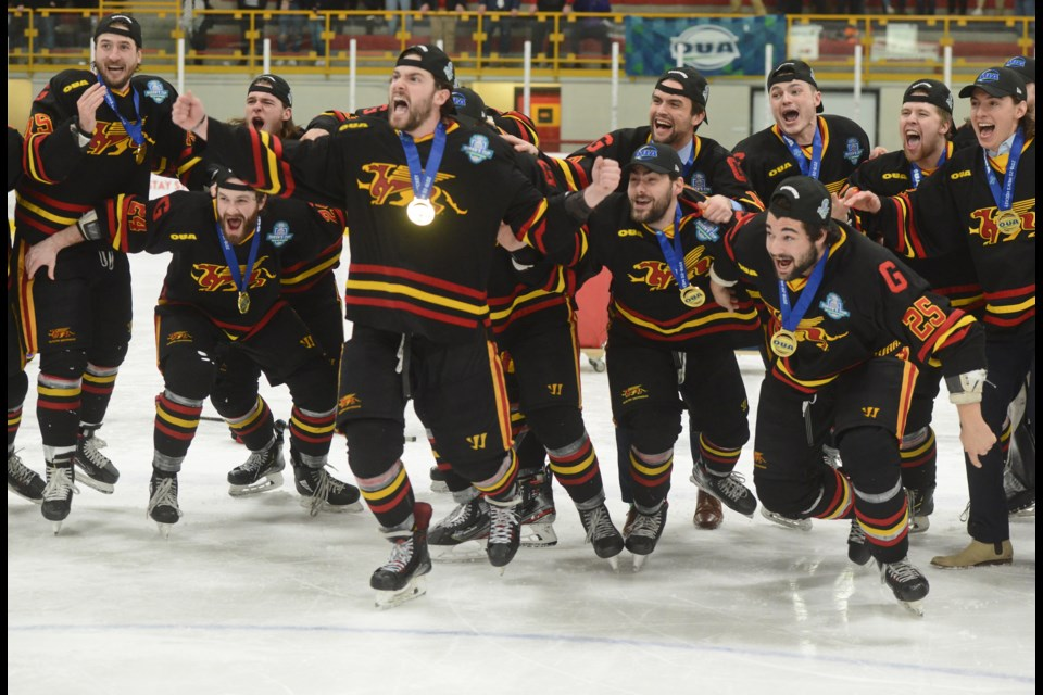 The Guelph Gryphons erupt as their captains bring over the Queen's Cup Saturday at the Gryphon Centre. Tony Saxon/GuelphToday