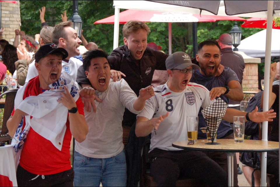 Patrons at The Fat Duck Gastro Pub celebrate an England shootout goal during the Euro Cup final on Sunday.