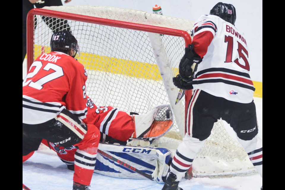 Guelph's Braeden Bowman is stopped by Niagara goaltender Joseph Costanzo in tight.