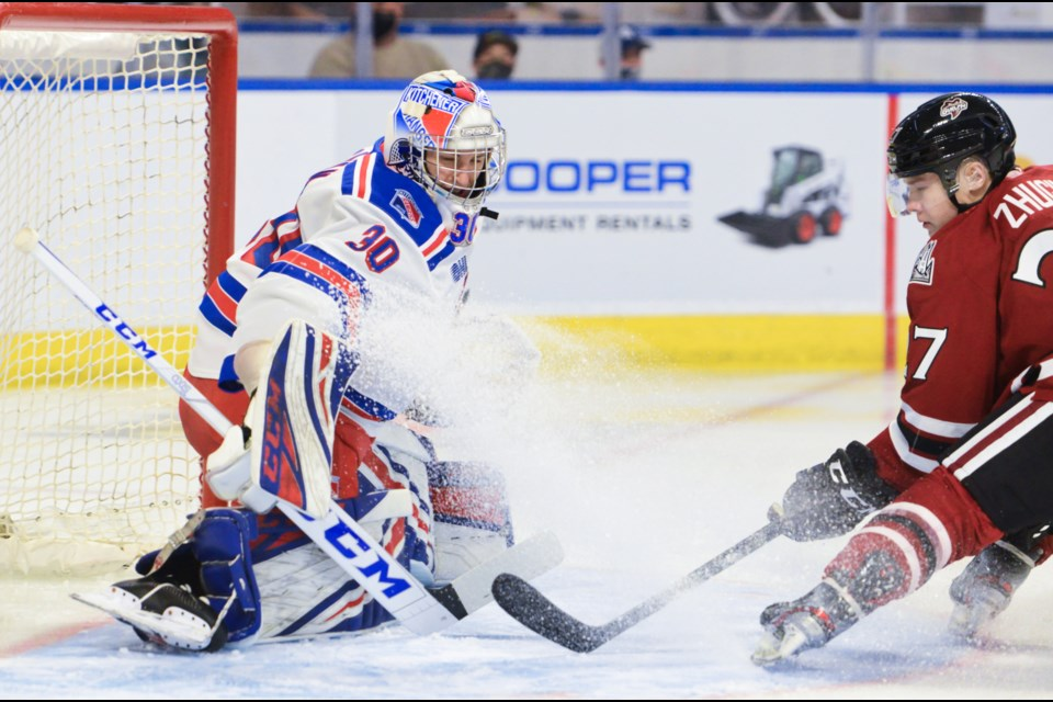 The Guelph Storm's Danny Zhilkin can't quite get to a cross-ice pass in front of Kitchener Rangers goaltender Pavel Cajan Friday in the OHL season opener in Kitchener.