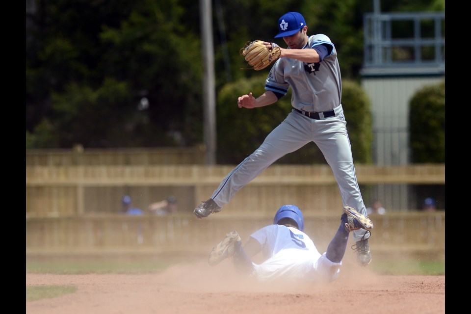 The Guelph Royals Aaron Loder steals second base underneath Toronto Maple Leafs shortstop Ryan White Saturday, May 21, 2016 at Hastings Stadium. Tony Saxon/GuelphMercury
