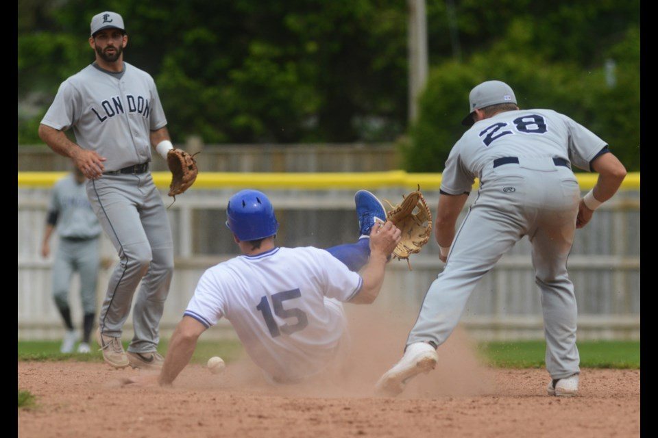 Guelph baserunner Josh Garton accidentally kicks off the glove of London Majors second baseman Jonathan Duforest as he slides into second base Saturday at Hastings Stadium. Tony Saxon/GuelphToday