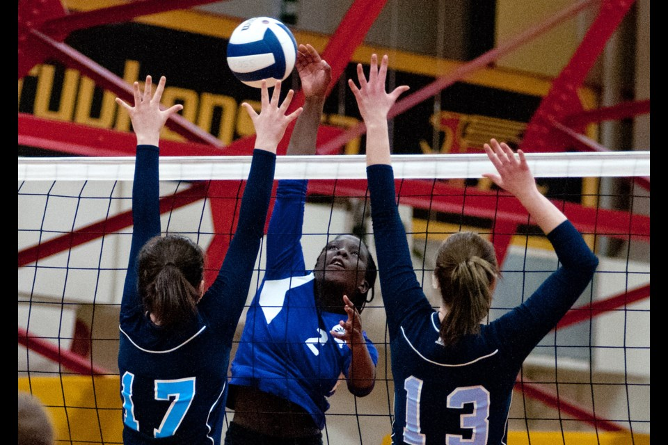 Rosy Omino (2) of the Centennial Spartans tries to drive the ball between the Ross Royals pair of Alyna Renkema (17) and Candice Geisel (13) during Friday's D10 senior girls' volleyball final. The Spartans won 3-2. Rob Massey for GuelphToday