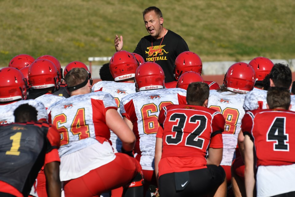 Guelph Gryphons head coach Ryan Sheahan talks to his players at the end of a training camp session at Alumni Stadium. Rob Massey for GuelphToday