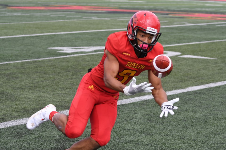 Receiver Jordan Terrio of the Guelph Gryphons keeps his eyes on the ball as he hauls in a pass during Guelph's 53-19 win over the York Lions Saturday at Alumni Stadium. Rob Massey for GuelphToday