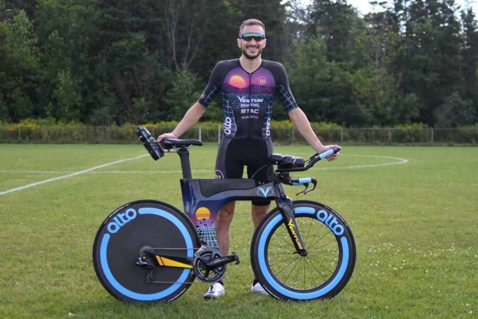 Guelph triathlete Cody Beals poses with his bike. He's been perfect with three wins in as many Ironman triathlons in the past year. Rob Massey for GuelphToday