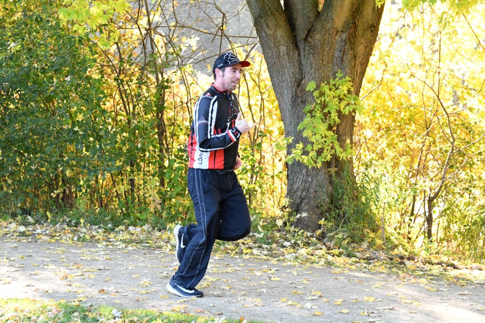 James Loaring of Loaring Personal Coaching and the LPC Triathlon Club runs in a park run in Guelph's York Road Park. Rob Massey for GuelphToday
