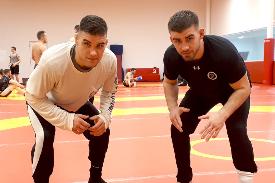 Alexander Chaves, left, and his brother Simon Chaves are hoping to bring more wrestling glory to the Guelph Gryphons and Guelph Wrestling Club. Rob Massey for GuelphToday