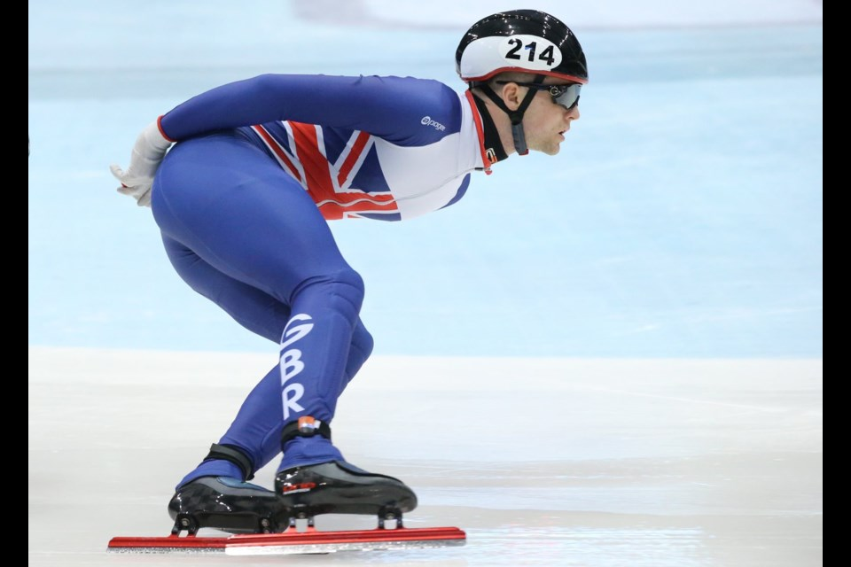 Westley Yates of Guelph races for Great Britain in a World Cup short track speed skating meet at Dresden, Germany. Martin Holtom photo