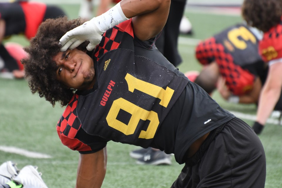 Defensive lineman Tavius Robinson of the Guelph Gryphons stretches during a training camp session at Alumni Stadium during the Gryphons' training camp Aug. 18, 2019. Rob Massey photo
