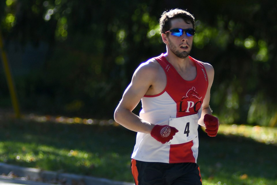 Pro triathlete Jackson Laundry of Guelph legs it out during the Thanksgiving Day Road Races around Exhibition Park in October of 2016. Rob Massey photo