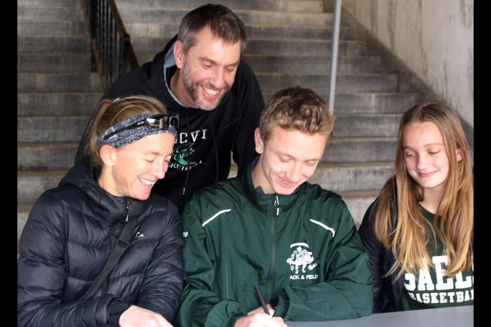 Tennessee Tremain is surrounded by his family – mother Teresa Duck, father Rich Tremain and sister Acadia Tremain – as he signs his Letter of Intent to attend and compete in track and field for Monmouth University in New Jersey beginning next August. Submitted Photo