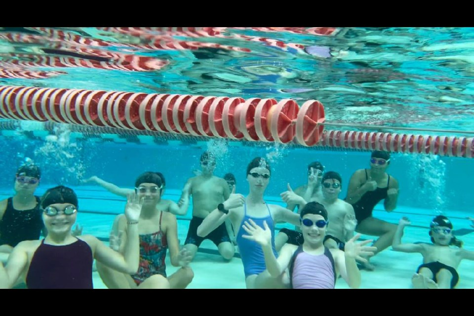 Members of one of the groups for the Wellington County Waves swim club pose for an underwater photo at the University of Guelph Pool. The Waves are a new swim club in the area that hopped in the pool for the first time earlier this month.