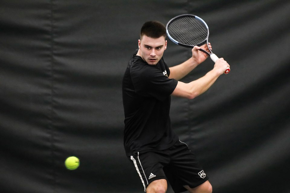 Zac Faveri of Guelph keeps his eyes on the ball as he gets set to hit a return in NCAA tennis play. The John F. Ross graduate and former District 10 high school champion is the captain with the Western Michigan University Broncos. Submitted Photo