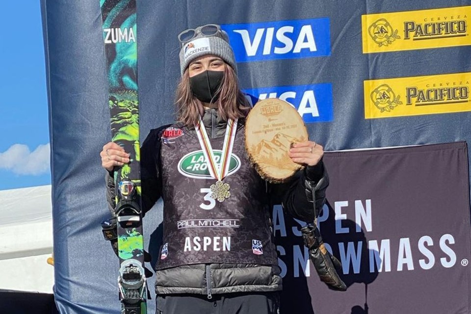 Rachel Karker of Erin shows off her winnings after placing second in the women's halfpipe event at the world freestyle skiing championships at Aspen, Col., last month. Submitted photo