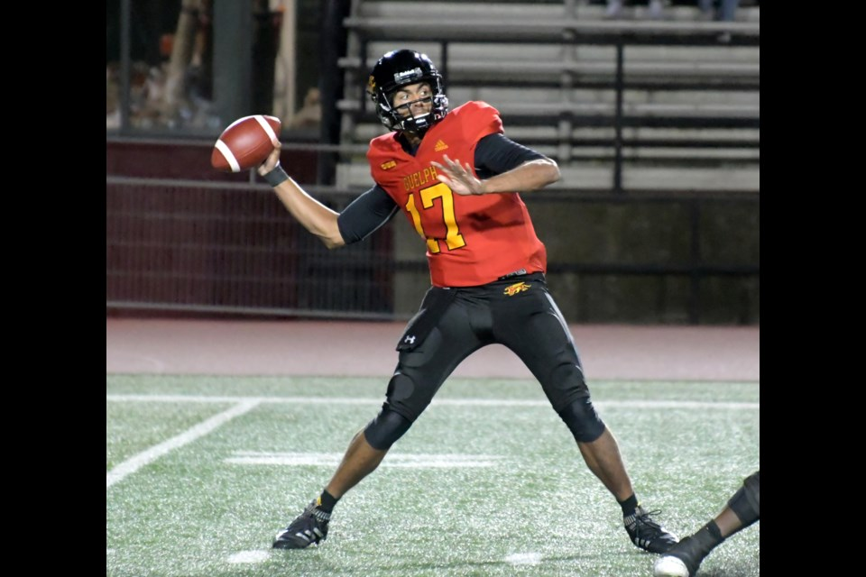 Quarterback Shawn Lal of the Guelph Gryphons reaches back to get ready to unleash a long pass during OUA football action Saturday at Alumni Stadium. The Gryphs defeated the Western Mustangs 23-21.