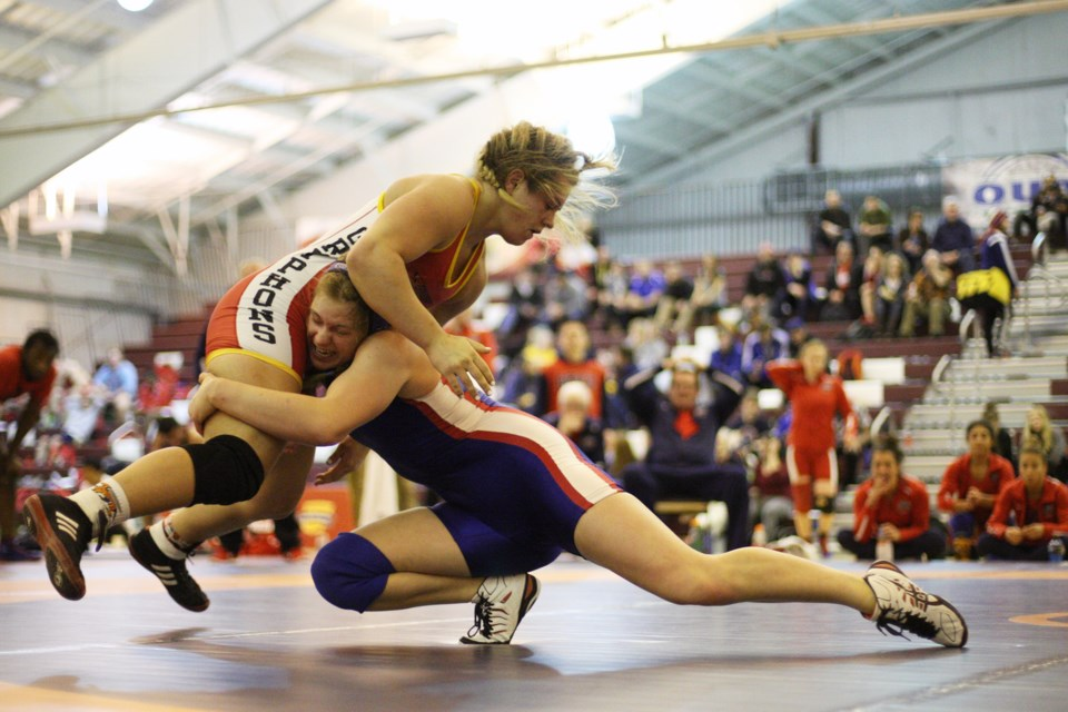 Guelph University wrestler Allison Carrow is thrust airborne by Jessica Brouillette of Brock University during their gold medal match in the 67kg category during the 2016 OUA Wrestling Championships in Sault Ste. Marie, Ont. Kenneth Armstrong/SooToday