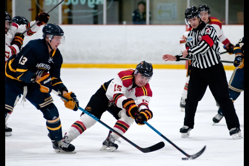 Cody Thompson (15) of the Guelph Gryphons reaches for the puck in front of Kyle Hope (43) of the Windsor Lancers. The Gryphs won their playoff opener 6-2 Thursday night at the Gryphon Centre. Rob Massey for GuelphToday