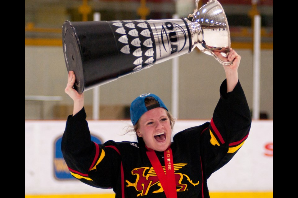 Averi Nooren of the Guelph Gryphons holds the McCaw Cup aloft after the Gryphons won the OUA women's hockey final 5-1 over the Western Mustangs Saturday at the Gryphon Centre. Rob Massey for GuelphToday.