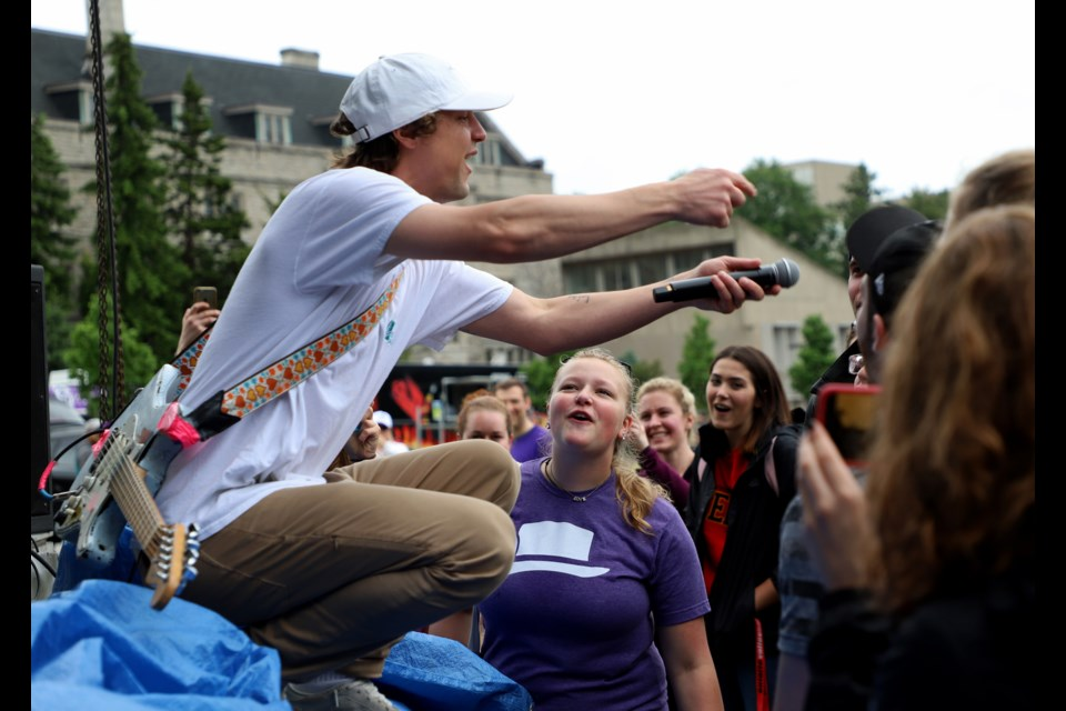 Hollerado's lead singer, Menno Versteeg, jumps down from the stage to encourage audience members to sing. Karen Tran for GuelphToday