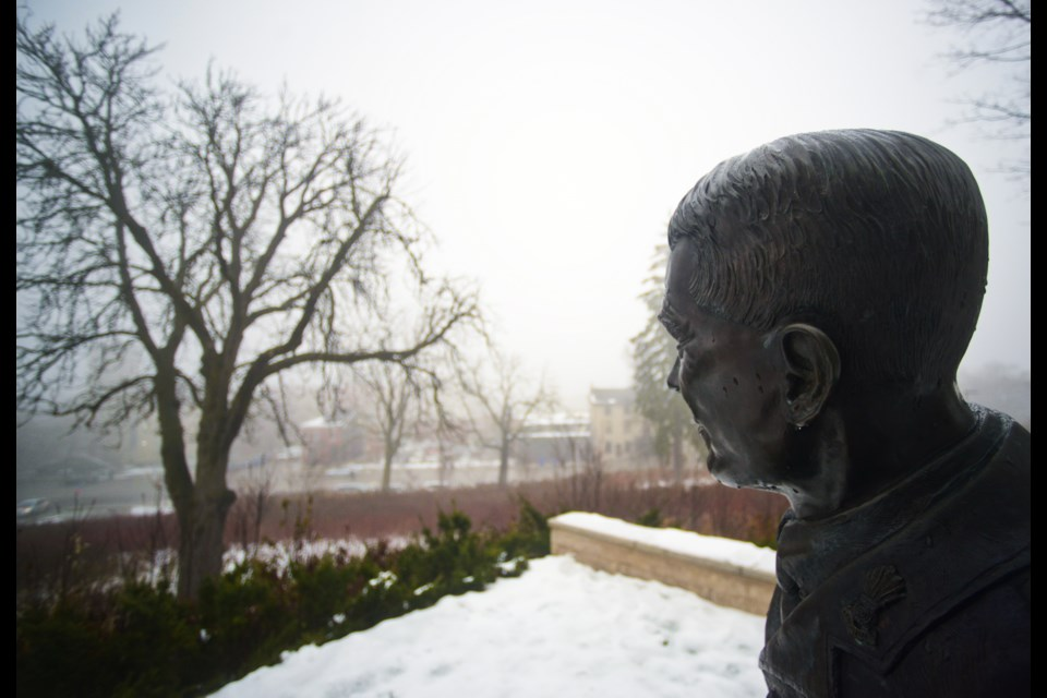 Lt. Col. John McCrae looks out over Downtown Guelph from his perch outside the Guelph Museums on a very foggy Tuesday morning. Tony Saxon/GuelphToday