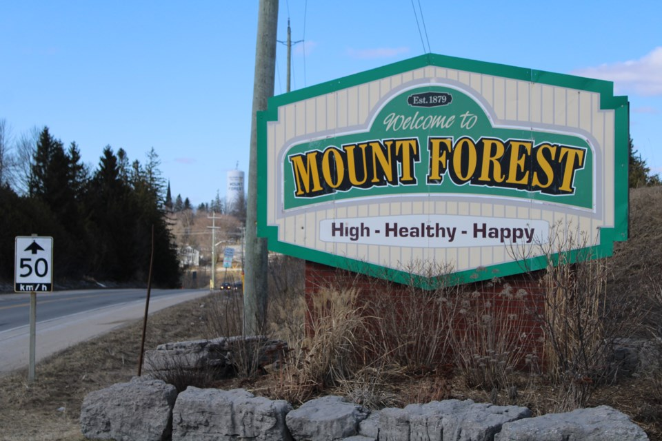 The previous Mount Forest sign including the 'High Healthy Happy' slogan. Keegan Kozolanka/GuelphToday file photo