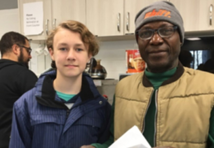 Quintin (left) stands with manager of The Drop in Centre, Emmanuel Asanya (right). Supplied photo.
