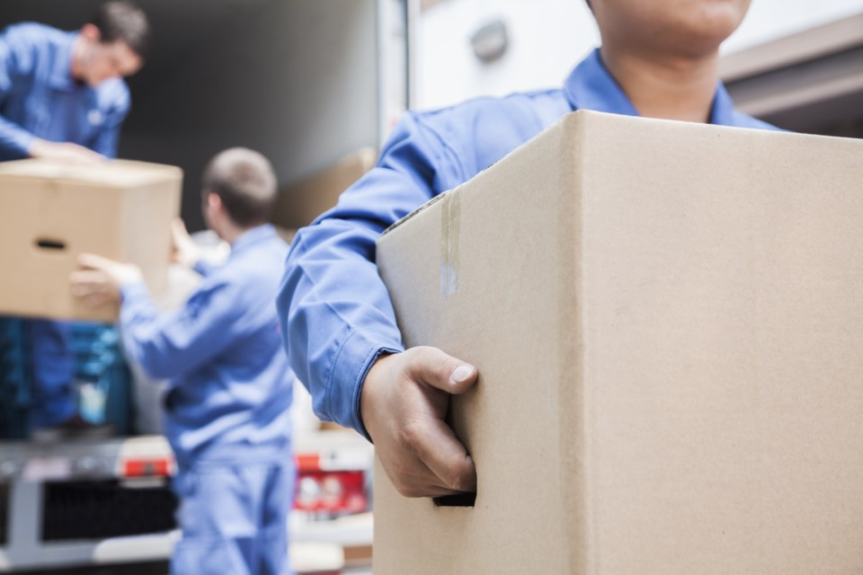 062719-movers-moving day-moving truck-movers-AdobeStock_55839525