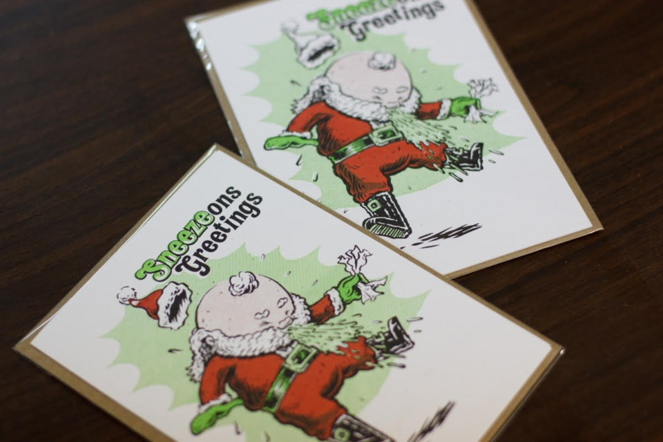 """Moore says his Christmas tree allergy inspired him to make the """"Sneezons Greetings"""" cards. (Contributed/Matt Parsons)"""