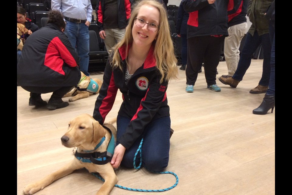 Kaitlyn Flemming is training Archie to be a PTSD service dog.