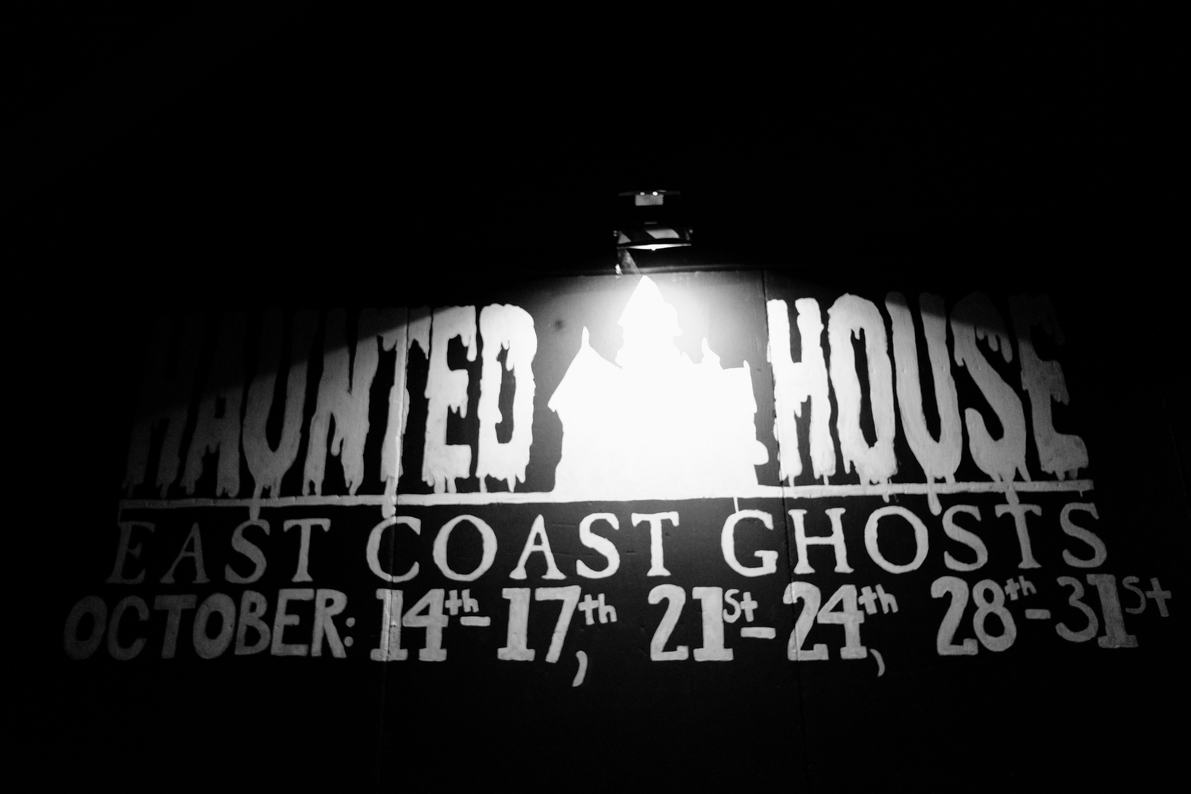 A sign listing the opening times of the Bluenose Ghosts Festival Haunted House