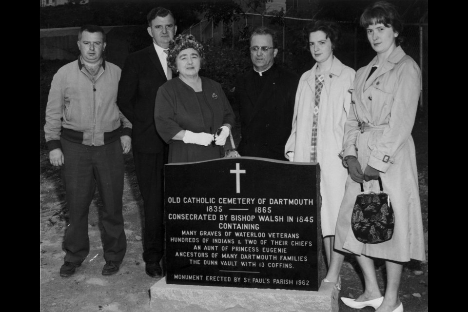 Unveiling of Geary Street (St. Paul's) Cemetery monument with Father Laba and members of the Dunn family. From left to right: Mike Dunn, Paul Dunn, Florence Dunn, Father Michael Laba, Alayne (Dunn) Boxall and Frances (Dunn) Tomscha. Photo Courtesy of the Dartmouth Heritage Museum.