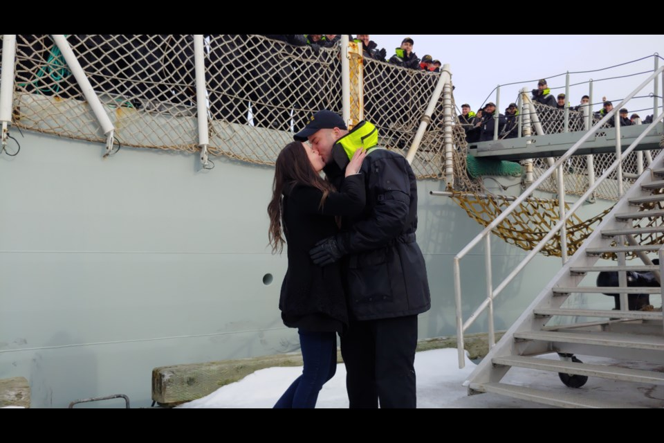 Leading Seamen Oliver Langille was first off HMCS Halifax, and was greeted by his new fiance, Kelsey Deblois.(Matthew Moore/HalifaxToday.ca)