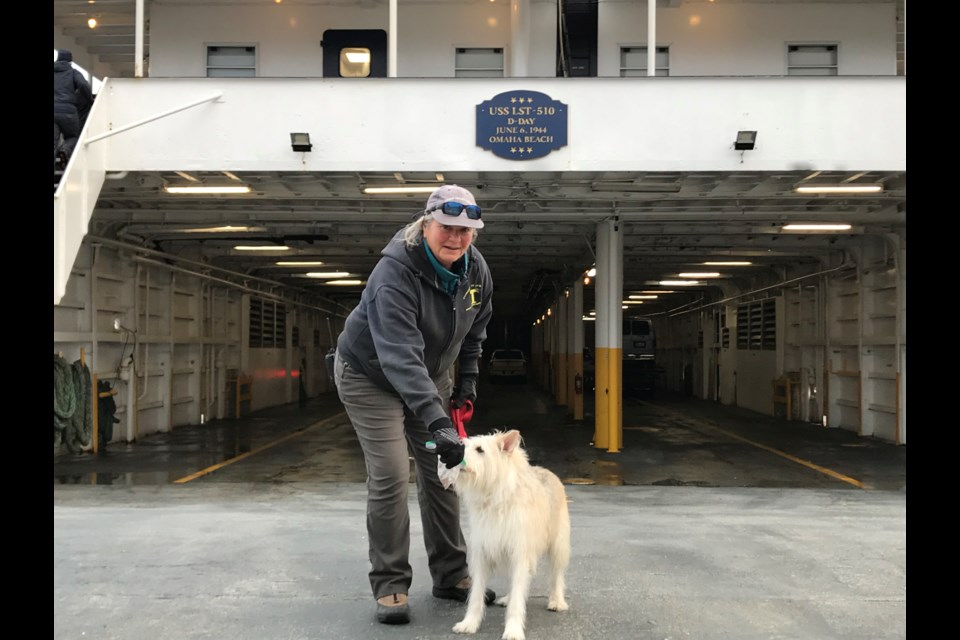 A Cape Henlopen crew member shares a treat with Smitty. (MacNab)