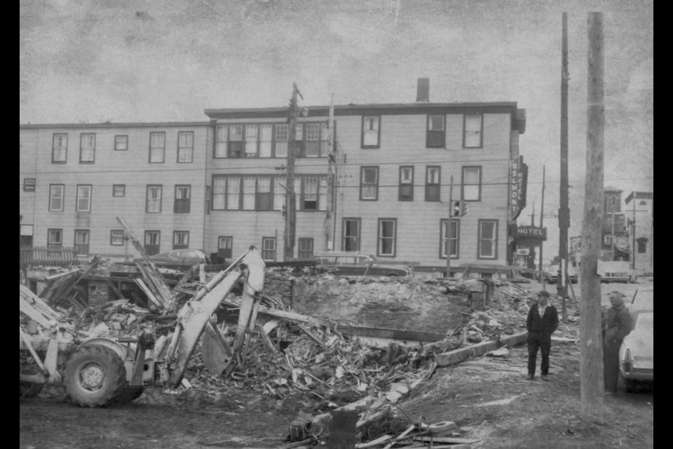 Alderney Drive (Commercial St.), at foot of Ochterloney. Demolition of old house + store opposite Belmont Hotel. (Photo courtesy of the Dartmouth Heritage Museum)