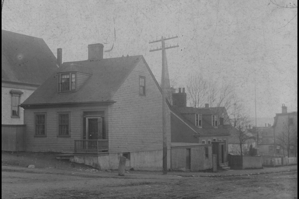 Corner of King Street and Ochterloney Street. The historic buildings housing today's Humble Pie Kitchen (77 King Street) and Machum's Café (44 Ochterloney Street) are shown. (Photo courtesy of the Dartmouth Heritage Museum)