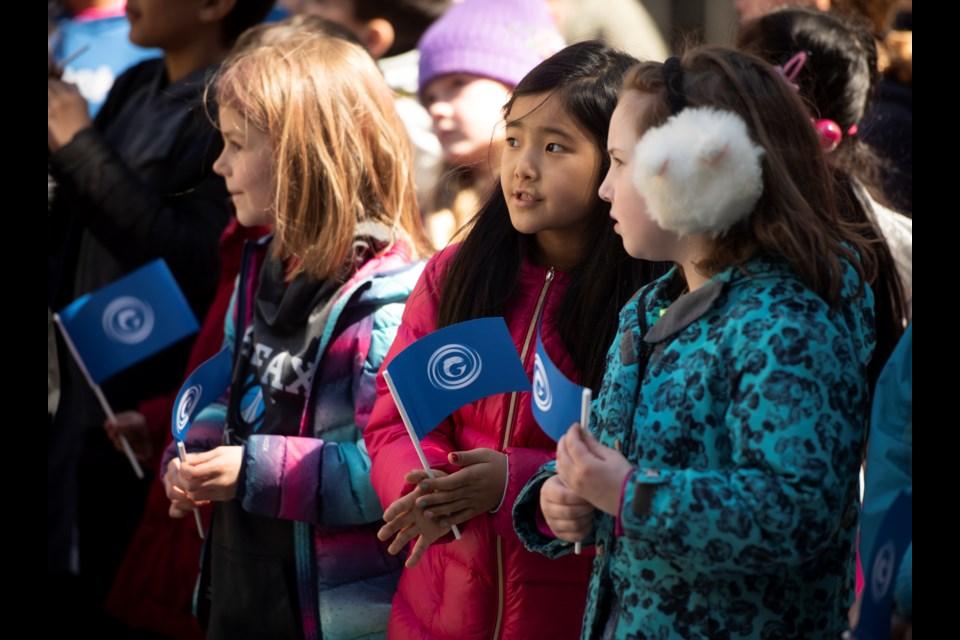Three students at the flag raising (Photo courtesy of Communications Nova Scotia )