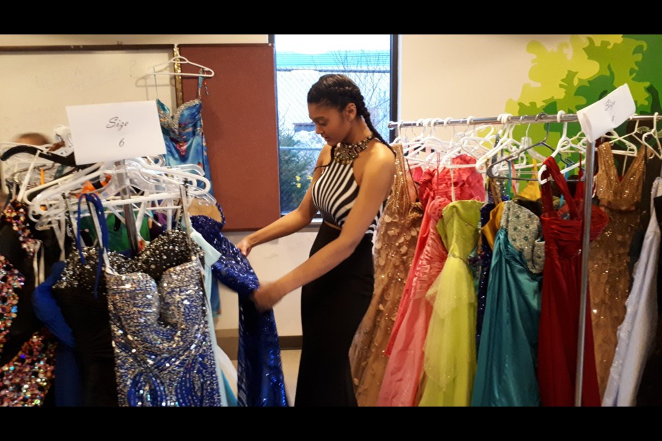 Grade 11 student Jasmine Lethbridge checks out some of the dresses. (Alex Cooke/HalifaxToday.ca)