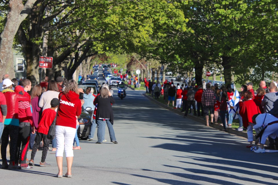 A procession honouring the Canadian Forces Snowbirds team member and Halifax native Captain Jenn Casey making its way through north end Halifax (Photo: Katie Hartai/HalifaxToday.ca)