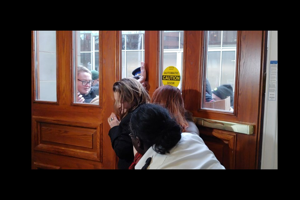 Deputy Prime Minister Chrystia Freeland squeezes through the door at Halifax City Hall (Matthew Moore/HalifaxToday.ca)