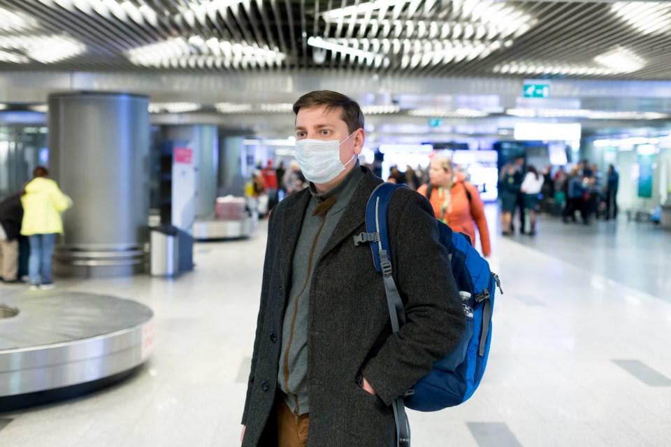 061820 -  mask airport AdobeStock_319552563