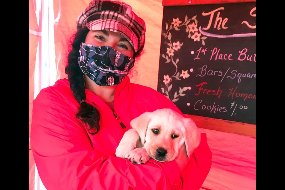 Jaime Grant, Innisfil Farmers' Market manager, welcomes Jerry the Puppy on the last day of the 2020 season. Submitted.