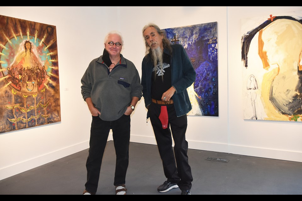 Ted Fullerton, left, and Dazaunggee, in conversation at be contemporary gallery in Stroud.