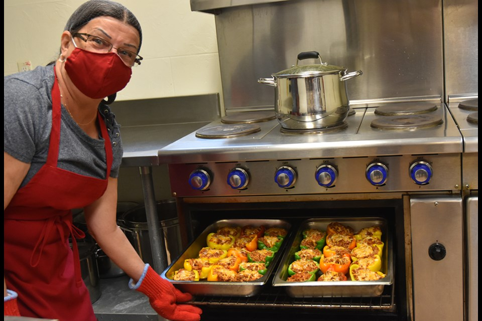 Wendy Hollingshead cooks up a rainbow of stuffed peppers in the Legion's kitchen.