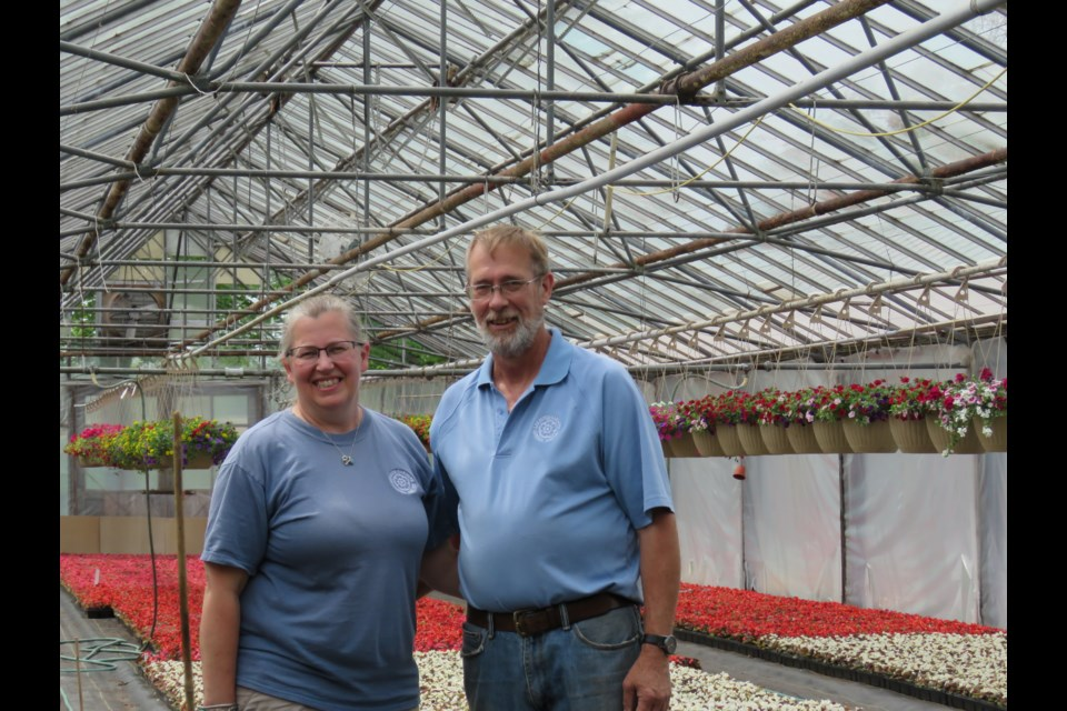 Rosemarie and Rob Radcliffe are a married couple working with their children and Rob's parents in the business specializing in hanging baskets, annuals, herbs and vegetables. All work is done by the family and there is no automation.